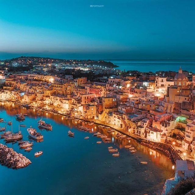The island of Procida is even more beautiful after a summer sunset ? ? Photo @peppnapp * *#enjoythecoast #procida #procidaisland #lacorricella #Italiancapitalofculture #lightblue #awesomeearth #islandprocida #bestplacesmagazine #italy_vacations #italiainfoto #procidaitaly #ig_italy #italytrip #wonderful_places #italian_places #best_italiansites #igersitalia #italy_vacations #traveltheworld #italytrip #destinationearth #earthpix #awesome_earthpix #bestitaliansites #ilpostino